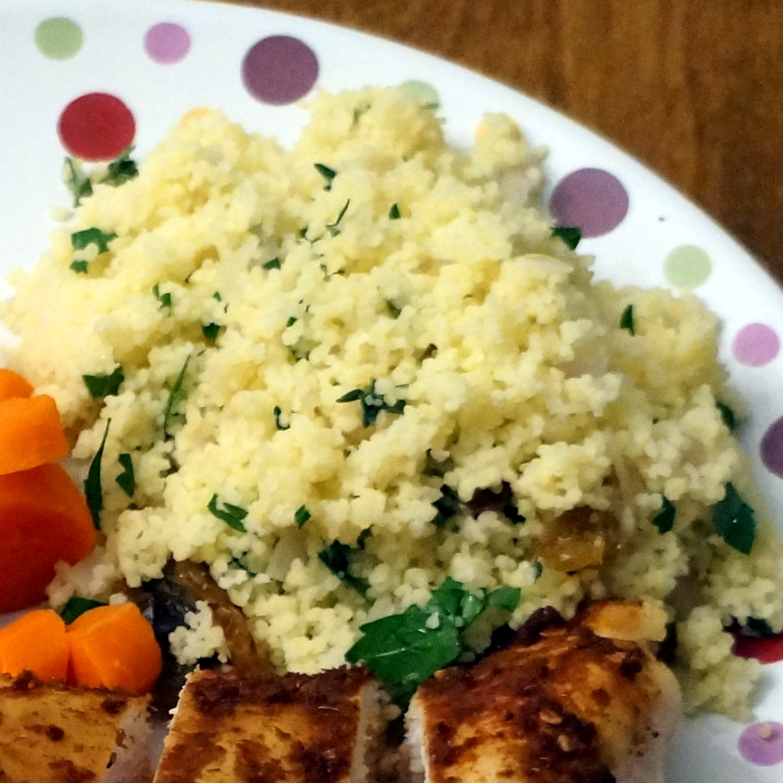 Herbed Couscous Pilaf with Golden Raisins and Pine Nuts